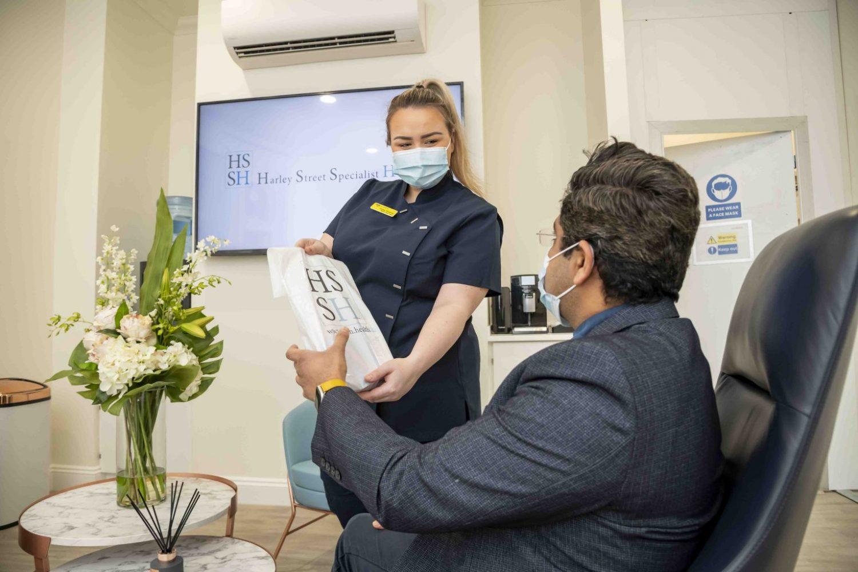 nurse handing a patient a bag